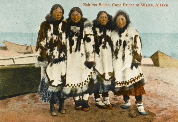 Four Eskimo Ladies from Cape Prince of Wales, Alaska. The woman on the left is wearing (interestingly) a very western pair of lace-up shoes as opposed to her fellows in traditional fur boots!