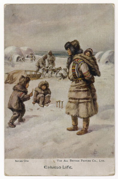 Four sleigh dogs are harnessed ready for action. Young eskimos play in the snow