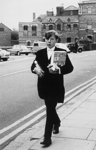 An Eton schoolboy going nonchalantly into town. Date: 1950s