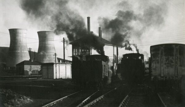 Evocative Railway scene with Cooling Towers. Two small steam engines in a sding close to a Power Station and a signal box in Scotland