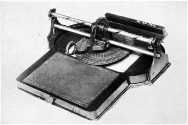 Photograph of a type writer from 1830, worked by an unusual vertical ratchet arrangement