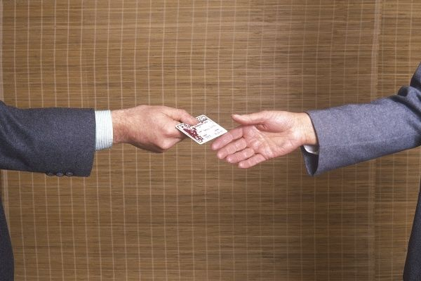 Exchanging a business card. Date: 1987