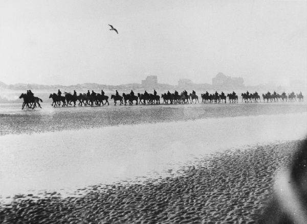 British army horses are exercised on a beach in Northern France Date: 1916