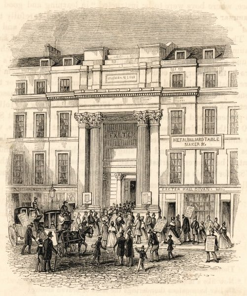 Exeter Hall: the Strand entrance, with people arriving for a meeting