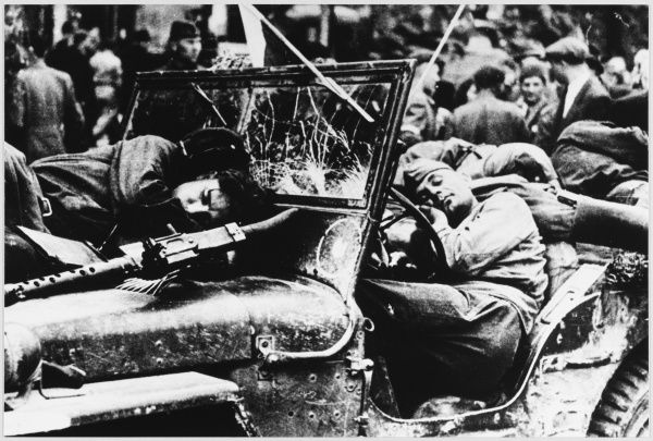 Exhausted Russians resting in Prague in the course of their advance towards Germany