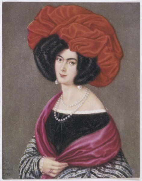Hair dressed in large sausage curls; large red turban; huge pearl drop earrings; pearl necklace; red scarf; gown with black bodice, lace tucker & striped gigot sleeves