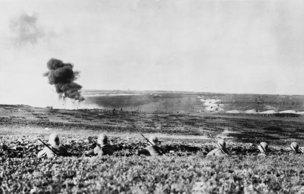 Shell exploding near German troops manning a trench on the Western Front during World War I