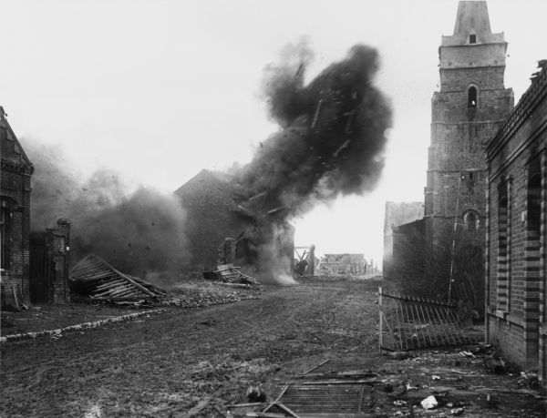 Explosion in a house set on fire by the enemy in Mons-en-Chaussee in France on the British front during World War I in March 1917