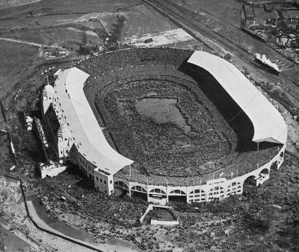 Aerial photograph of Wembley Stadium before the start of the 1923 F.A. Cup Final between Bolton Wanderers and West Ham United. This was the first Cup Final held at the then brand-new Wembley Stadium, which had been built in 300 days at a cost of 750,000
