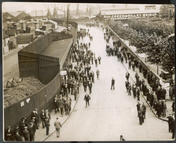 Factory workers leaving the engineering and ship repairing factories of R. & H. Green and Silley Weir Ltd