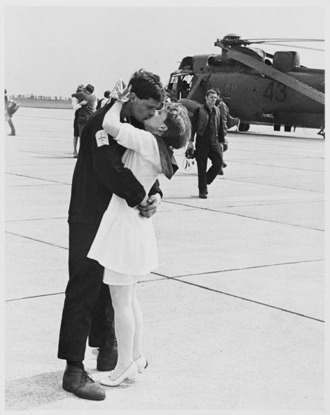 Veterans of the conflict are kissed by their wives and girlfriends on their return to Britain