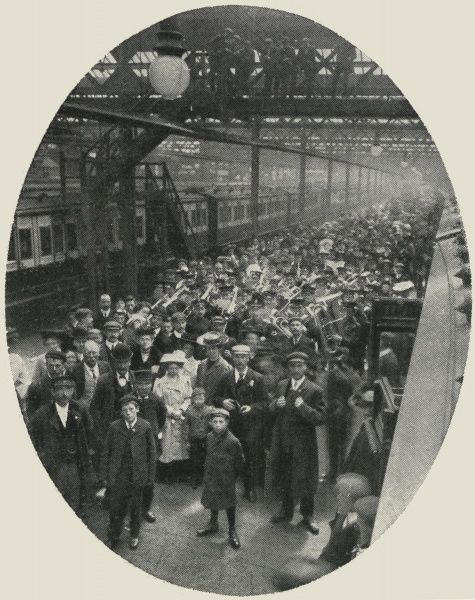 A group of families on the platform of a large railway station, about to emigrate to Canada with the assistance of the Salvation Army. An Army band accompanies their departure