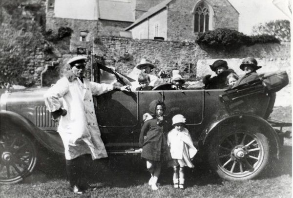 A large family car with passengers and chauffeur, probably somewhere in Pembrokeshire, South Wales