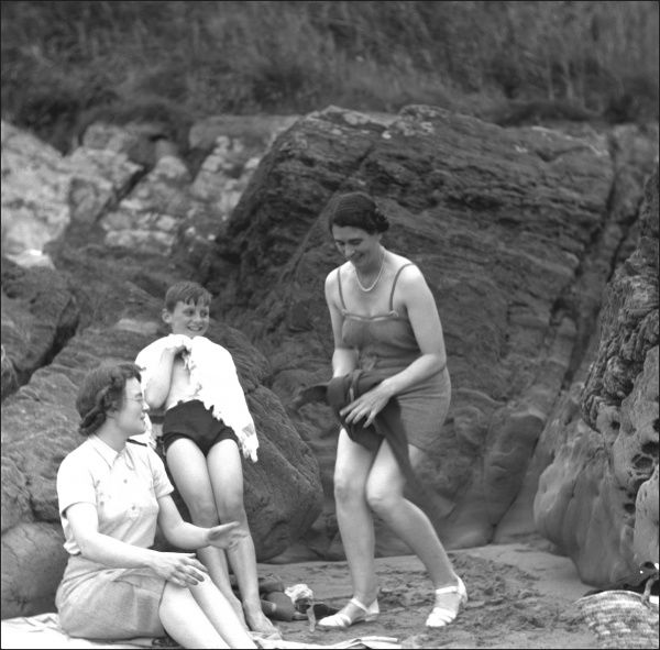 A family group of bathers at the seaside in Devon -- in the centre is Cecil Watts, and Olive Harper is standing on the right