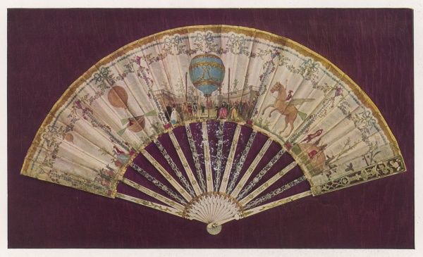 A silk folding fan with decorative carved sticks depicting various balloons and other attempts at flight, including those by Dollfus and Montgolfier