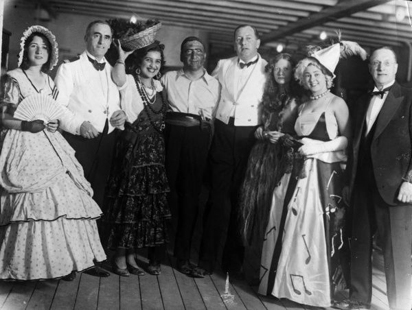 A group on board the 'Andalucian' ship, in fancy dress for a ball. Date: 1935