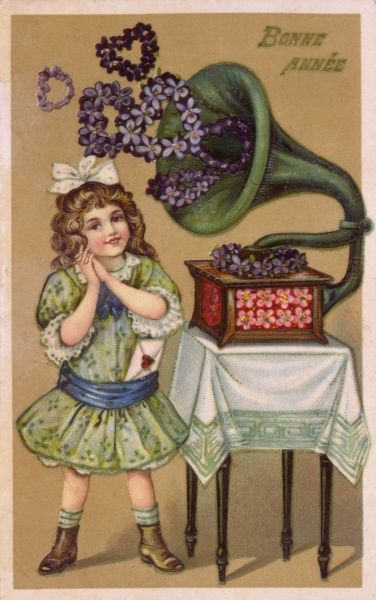 A girl listens as the gramophone issues flowery hearts Date: 1911