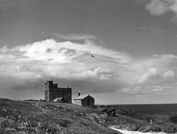 The squat Tower House, built about 1500 and St. Cuthbert's Chapel, all that remains of a church built here by the Master of the Farne, c.1370, Farne Islands, Northumberland. Date: early 16th century