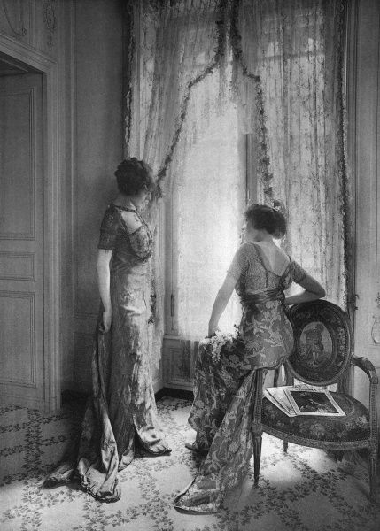 comparing dresses in the salon of CALLOT SOEURS Date: 1910
