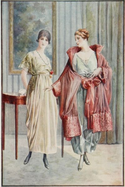 Two elegant dresses modelled by ladies, one of whom is wearing a sumptuous pink overcoat