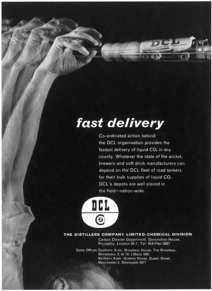 Advertisement for the DCL (The Distillers Company Limited). Thei 'fast delivery' is illustrated here by a tanker being throw fast like a ball from a man's hand. Photographic montage by Heinz Zinram