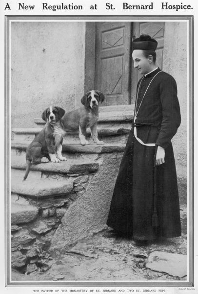 The Father of the Hospice du Grand Saint Bernard, with two of it's famous dogs which are trained to rescue unfortunate travelers who lose their way in the darkness and snow on the Alpine pass