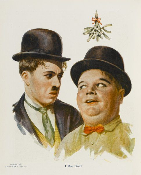 ROSCOE 'FATTY' ARBUCKLE American film actor under the mistletoe with Charlie Chaplin