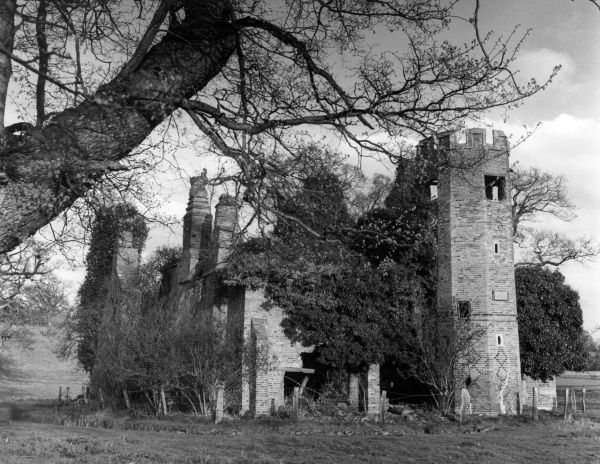 The ruins and tower of the Dower House, a former lodge in Fawsley Park, Fawsley, Northamptonshire, England. Date: 17th century