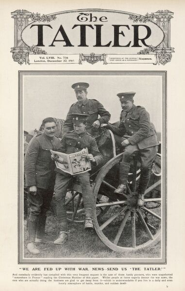 A photograph of First World War soldiers reading The Tatler 'somewhere in France', for a little light relief