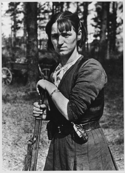 A female resistance fighter with her gun