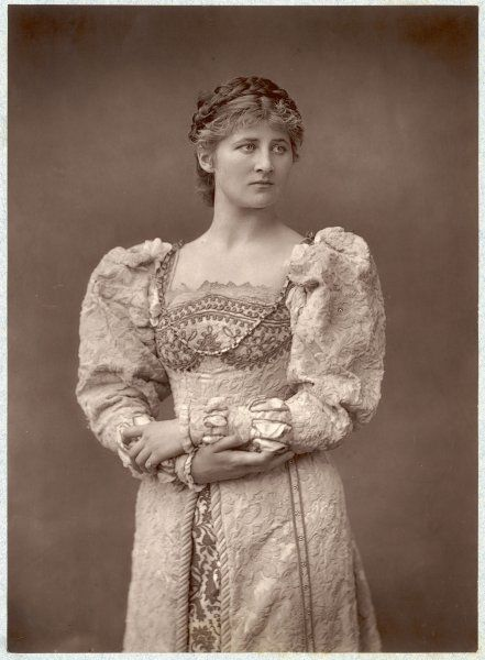 An American actress looking strong and proud in an elaborate brocade dress: Mary Anderson (1859-1940)