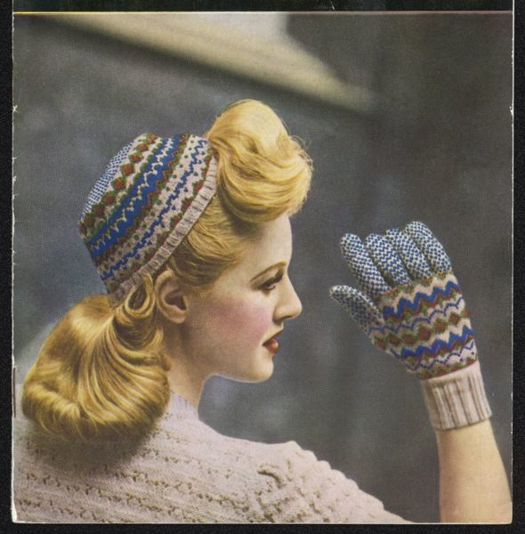 Attractive blonde models her knitted fairisle cap and gloves