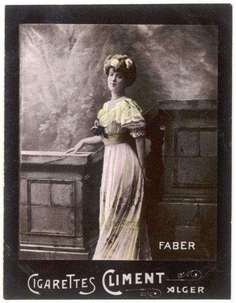 A demure young woman in a fairly modest dress