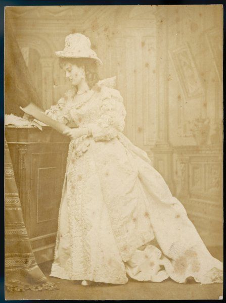 An elegant Victorian woman in an elaborate white dress: Mrs Sassoon, possibly an actress