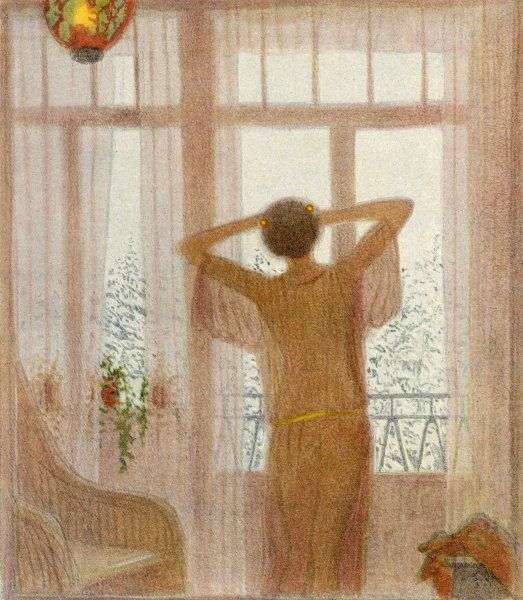 A woman stands at the window at twilight in a transparent dressing gown