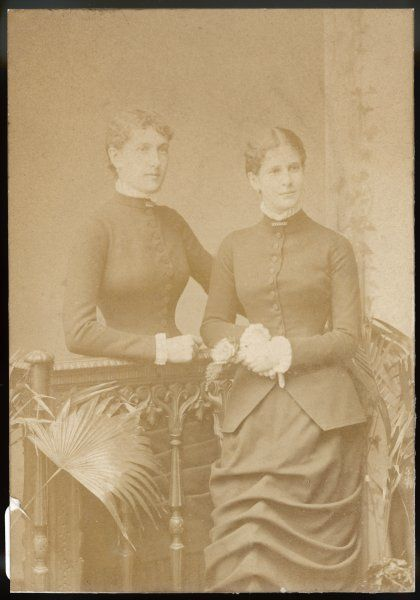 Two Victorian women pose in the photographer's studio: Mrs L de Rothschild and Mrs Amuan