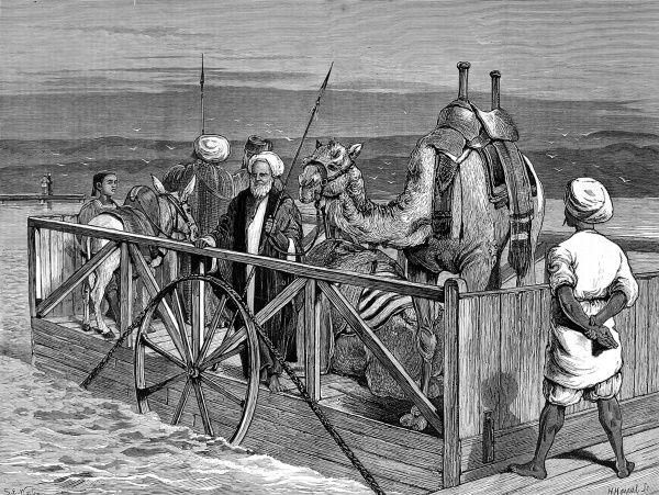 Engraving of the small rope ferry at Kantara, crossing the Suez Canal with several passengers, two camels and a donkey. The ferry was operated by means of an underwater rope, in a similar style to modern day chain-ferries