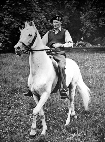 Photograph showing Field-Marshal Montgomery riding a white Arab stallion, Germany, 1945. This horse was procured by the Germany army in 1941, with the intention that General Rommel should ride into Cairo, if the Germans captured the city. They did not
