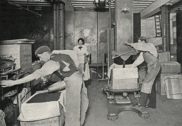 Workers filling, weighing and packing chests of tea at Messrs Traver's Wharf, Bankside, London. Date: circa 1902