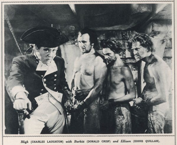 Mutiny On The Bounty, an M.G.M film about seafaring and romance, staring Charles Laughton and Clark Gable. The film still shows Charles Laughton as Bligh, with Burkitt (Donald Crisp) and Ellison. (Eddie Quillan)