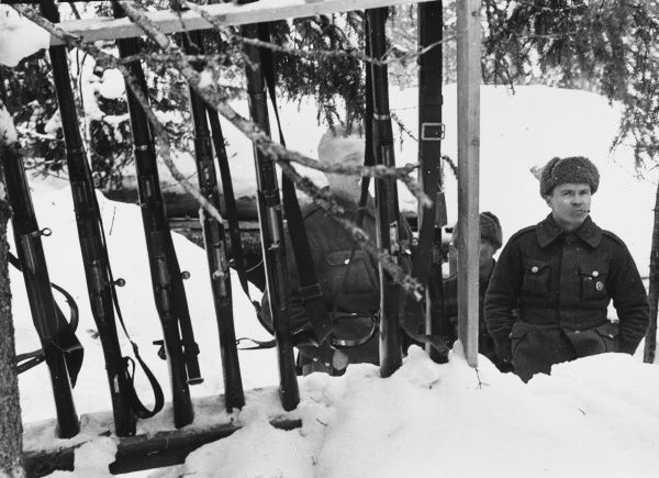 Soldiers standing in defences in Finland during World War II