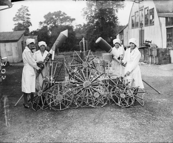 Women from Brook's fireworks factory, one of the oldest British fireworks companies, show off a selection of their huge rockets and catherine wheels