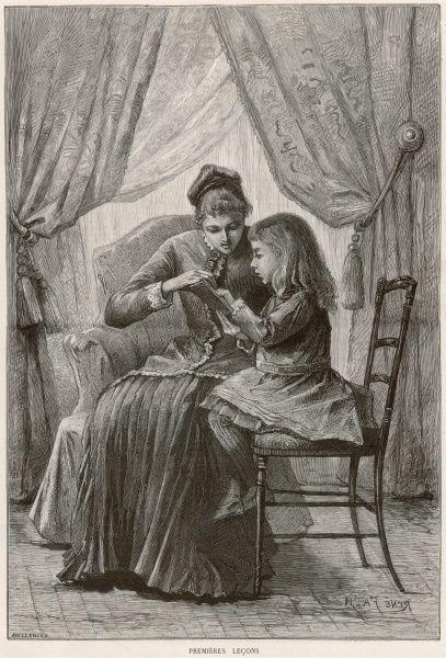 A young girl practises reading with her mother