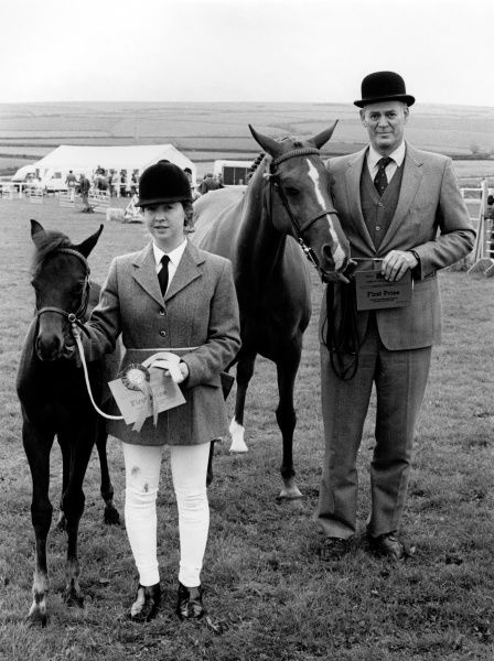 A mare and foal, winners of the first prize at the Royal Cornwall Agricultural Show, with their owners. The Show takes place at the beginning of June each year, at Wadebridge in North Cornwall. The show lasts for three days and attracts approximately 120