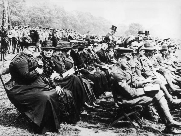 Widows and next of kin sit at a First World War medal ceremony waiting to receive medals on behalf of their relatives