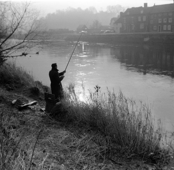 An angler casts his line out into the River Severn in the misty morning light at Bewdley, Worcestershire. Photograph by Norman Synge Waller Budd