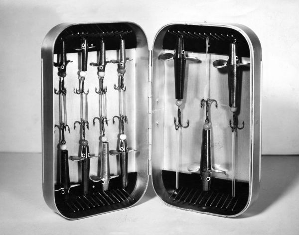 Fishing lures in a neat case. Date: 1960s