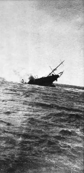 A Fleet Minesweeper sinking after striking a mine during the First World War. Date: 1914-1918