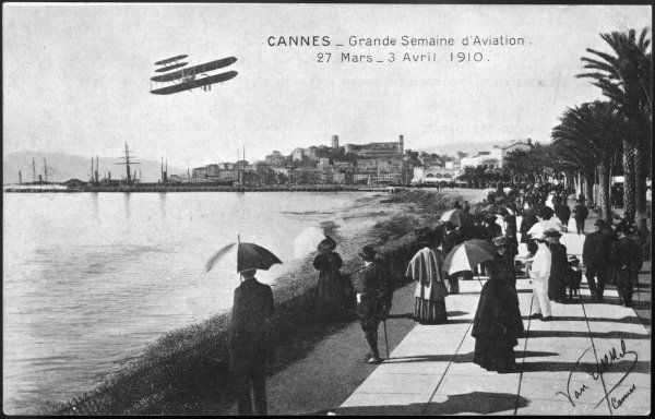 'Grande Semaine d'Aviation' at Cannes, on the Cote d'Azur - watching a biplane fly over the bay