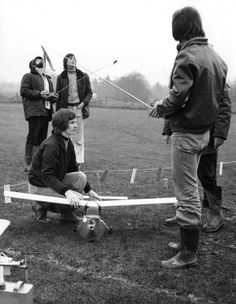 A group of young men fly model aeroplanes Date: 1970s